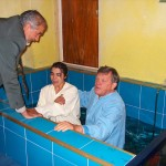 Carl baptizing an beleiver at John's church